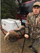 Gabriel Nissen with his deer skinned and packed in the cooler.