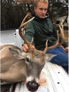 Hunter Nissen is shown here with his whitetail buck.